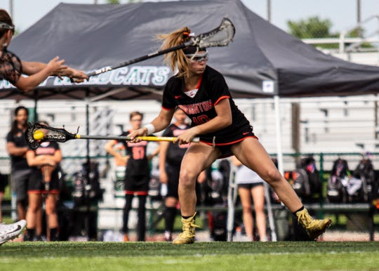 Brighton's Cat Kopchia scored two goals in the state championship lacrosse game against Rockford on Saturday, June 8, 2019, but was ejected after receiving her second penalty late in the first half.