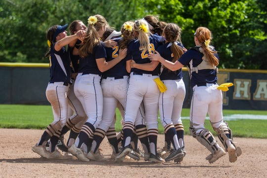 Hartland celebrates a 7-6 victory over South Lyon East in the regional championship softball game on Saturday, June 8, 2019.