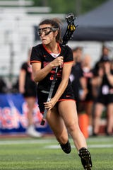 Brighton's Alyssa Yaggie handles the ball in a 21-6 loss to Rockford in the state Division 1 lacrosse championship game at Novi on Saturday, June 8, 2019.