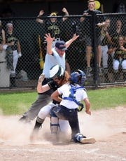 Howell's Rosie McQueen slides home with the only run in a 1-0 victory over Richland Gull Lake in the regional championship softball game on Saturday, June 8, 2019.