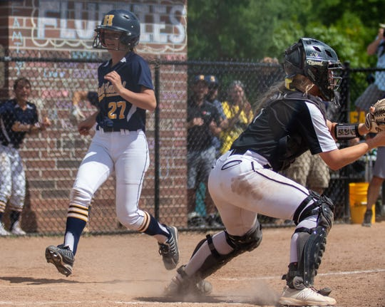 Sam Fritz scores the game-winning run in Hartland's 7-6 victory over South Lyon East in the regional championship game on Saturday, June 8, 2019.