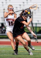 Brighton's Sophie Mondro, who scored four goals, is defended by Rockford's Anna Glynn during the state Division 1 lacrosse championship game at Novi on Saturday, June 8, 2019.