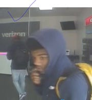 This is a surveillance camera image of a suspect in a robbery Saturday at a store in Holt.
