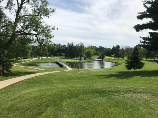 Hole No. 6 at Twin Lakes is another Par 3 with basically an island green with a pond surrounding it from the front left circling to the back. To the left backside of the green is No. 5 tee box and a cart path.