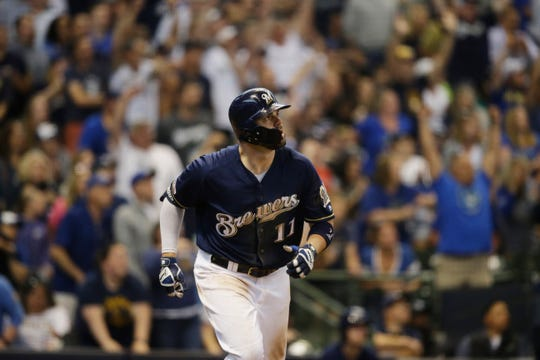 Mike Moustakas of the Brewers watches his two- run home run against the Pirates sail over the wall in right-center during the eighth inning Sunday.