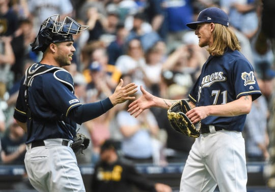Brewers closer Josh Hader celebrates the victory with catcher Manny Pina.