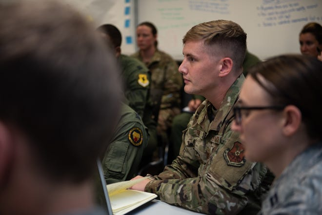 Squadron Officer School students listen as they receive initial feedback on their Think Tank elective presentation, May 31, 2019, Maxwell Air Force Base, Alabama. The students were given the challenge to figure out how Artificial Intelligence could be used to solve Air Force issues and better processes.