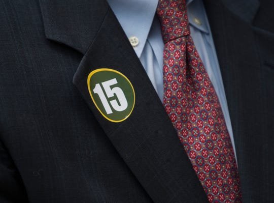Guest wore stickers with Starr's number 15 during a memorial service for NFL legend Bart Starr at the Wright Center in Birmingham, Ala., on Sunday, June 9, 2019.