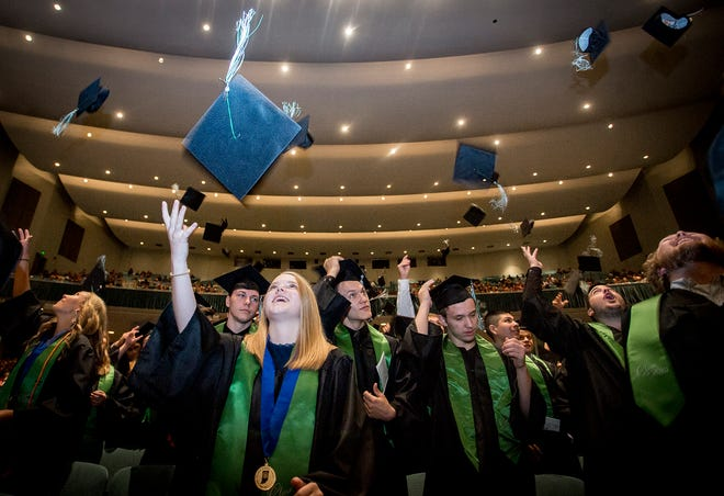 Yorktown's class of 2019 receives their diplomas during the school's commencement ceremony at Emens Auditorium Sunday, June 9, 2019.