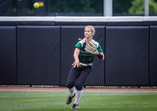 Yorktown's Savannah Baker returns a hit from New Palestine during their state final game at Purdue's Bittinger Stadium Saturday, June 8, 2019.