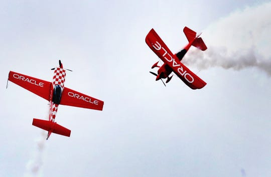 Jessy Panzer, left and Sean D. Tucker, right both with Team Oracle performs during The Great Tennessee Air Show on Saturday, June 8, 2019, at the Smyrna Airport.