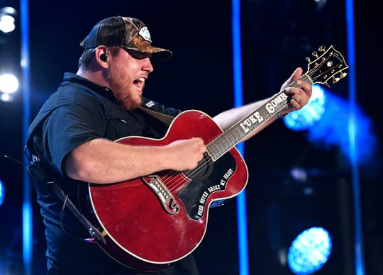 Luke Combs performs during the CMA Music Festival on June 8, 2019, at Nissan Stadium in Nashville.