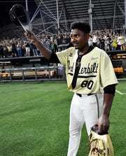 Vanderbilt's Kumar Rocker (80) tips his hat to the crowd after during the NCAA Division I Baseball Super Regionals at Hawkins Field Saturday, June 8, 2019, in Nashville, Tenn.