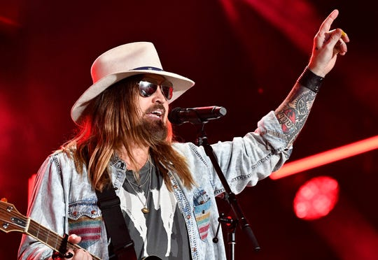 Billy Ray Cyrus performs with Lil Nas X and Keith Urban during the 2019 CMA Fest Saturday, June 8, 2019, at Nissan Stadium in Nashville, Tenn.