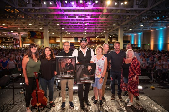 L to R: Paige Altone (Sony Music Nashville), Caryl Atwood (Sony Music Nashville), Randy Goodman (Sony Music Nashville), Chris Young, Sarah Trahern (CMA), Dennis Reese (Sony Music Nashville), Rob Beckham (The AMG Management), Alaina Vehec (Sony Music Nashville), Kent Earls (Universal Music Publishing Group)