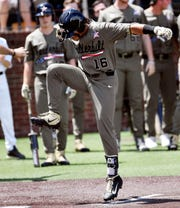 Vanderbilt third baseman Austin Martin (16) stomps on home plate after hitting a home run to make the score 1-0 over Duke in the first inning during the NCAA Division I Baseball Super Regionals at Hawkins Field Sunday, June 9, 2019, in Nashville, Tenn.
