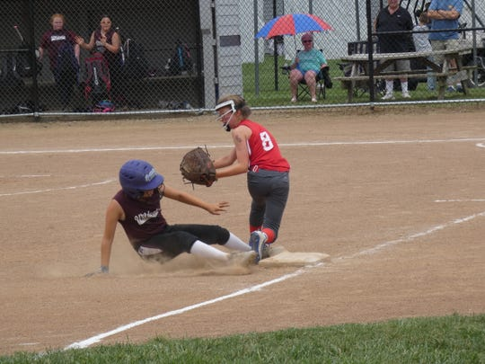 Newark Crimson's Lainee Erlenbach steals third base just ahead of the tag from Licking Valley's Corsi-Swick's Chloe Hunter on Sunday during the 10U championship game of the Licking County Shrine Tournament. Corsi-Swick won 5-2 to repeat as champion.