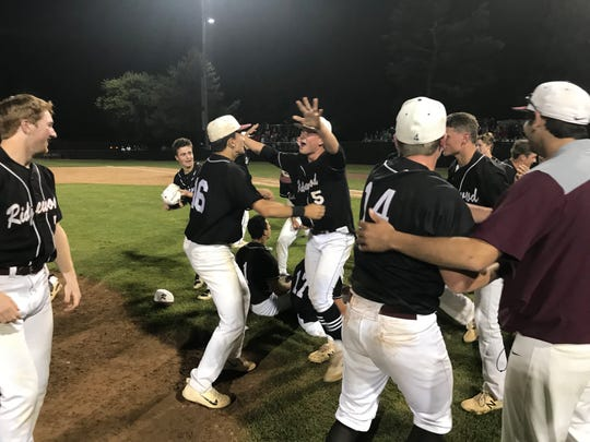 Anthony Stephan (16) and Kevin Seitter (5) celebrate with Ridgewood teammates near the mound after winning the NJSIAA Group 4 baseball title, 2-1, over Eastern Regional on Saturday, June 8, 2019.