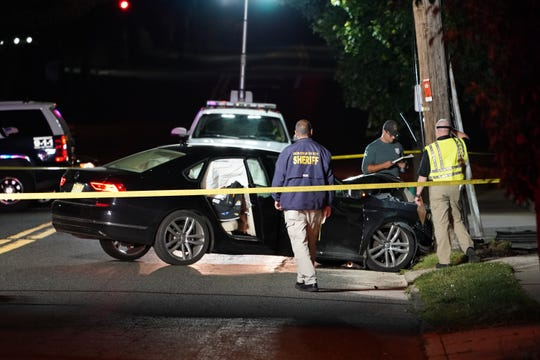 Police at the scene where a person was critically injured after a vehicle struck a pole on Passaic Street near Franklin Place in Hackensack, NJ around 9:20 p.m. on June 8, 2019. (Photo/Christopher Sadowski)