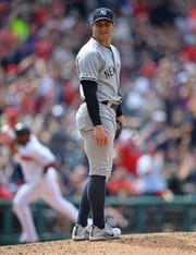 New York Yankees relief pitcher Tommy Kahnle waits for Cleveland Indians' Mike Freeman to run the bases after hitting a 2-run home run in the sixth inning of a baseball game, Sunday, June 9, 2019, in Cleveland. (AP Photo/David Dermer)