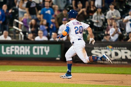 Jun 8, 2019; New York City, NY, USA; New York Mets first baseman Pete Alonso (20) rounds the bases after hitting a home run during the seventh inning against the Colorado Rockies at Citi Field.