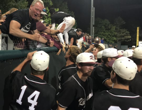 Ridgewood baseball players celebrate with fans after the Maroons' 2-1 victory over Eastern Regional in the NJSIAA Group 4 final on Saturday, June 8, 2019.
