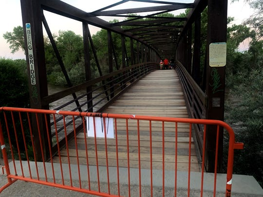 Visitors walking north over the Berg Bridge above a swollen Animas River around sunset June 8 encountered an orange barrier with a sign stating that the north side of the park's trail system is temporarily closed due to rising river levels. Trails on the park's south side remain open.