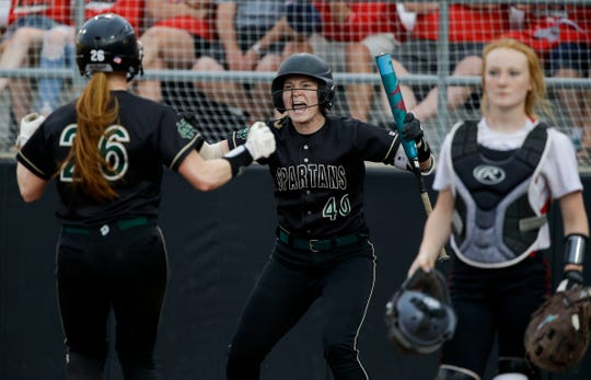 Oshkosh North High School's Sophie Averkamp (40) reacts as Sydney Supple (26) comes in to score against Sun Prairie High School during the Division 1 state championship game on Saturday, June 8, 2019, at Goodman Softball Complex in Madison, Wis. 