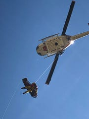 An injured youth who was hiking in a hard-to-reach spot north of San Jacinto was hoisted out of the location by rescue crews on a helicopter Saturday, June 8, 2019.