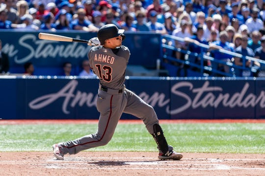 Jun 8, 2019: Arizona Diamondbacks shortstop Nick Ahmed (13) hits a sacrifice fly during the third inning against the Toronto Blue Jays at Rogers Centre.