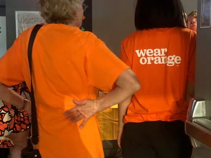 Volunteers attend the Wear Orange event on June 8, 2019.