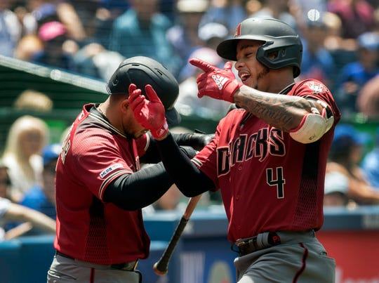 Arizona Diamondbacks' Ketel Marte, right, celebrates his solo home run against the Toronto Blue Jays in the third inning of their baseball game in Toronto on Sunday, June 9, 2019. (Fred Thornhill/The Canadian Press via AP)
