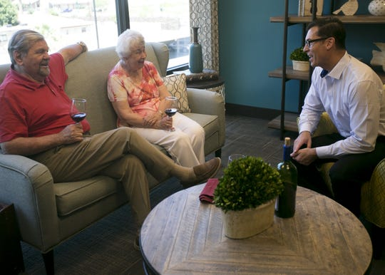 Mark Aronauer (right), the marketing director for 19th Avenue Operatons, speaks with David Pirtle (left) and Marilyn Pirtle (center) residents at the senior living community Palazzo during a photo opportunity in Phoenix, Arizona, on June 6, 2019. 19th Avenue Operations has begun re-designing the living facility into a modern, luxury stye complex.