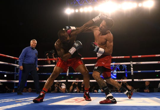 Reno's J.J. Mariano, right, takes on William Flenoy during a Top Rank boxing event at the Reno-Sparks Convention Center on Saturday.