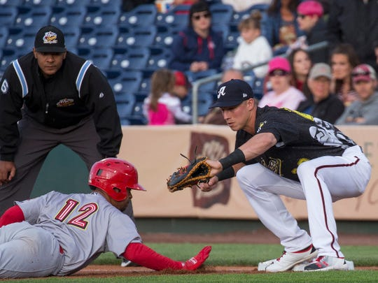 "Jake Lamb puts the tag on Memphis Redbird runner Edmundo Sosa (12) at first base as he begins an MLB rehab assignment during the Reno Aces ""Star Wars Night"" in Reno on Saturday, June 8, 2019."