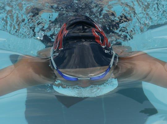 Shreveport's Hailey Myers swims in the 32nd Annual Damon McCoy Invitational held at Shreveport's Southside Swim Club.