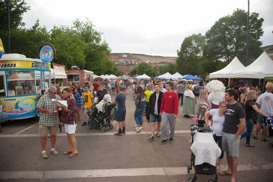 Community members gather in downtown St. George for the monthly Streetfest Friday, June 7, 2019.