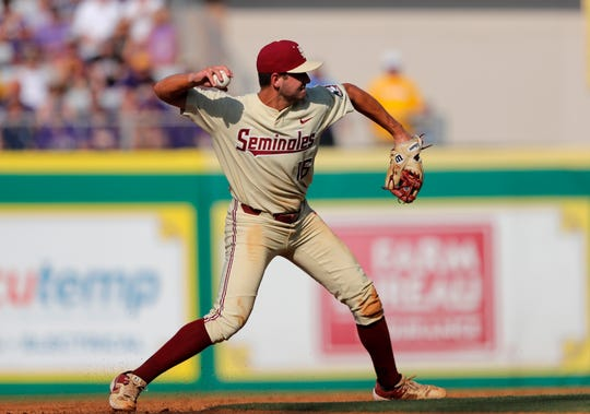 Florida State shortstop Mike Salvatore throws out LSU's Daniel Cabrera on a groundout in the second inning of Game 2 of the NCAA college baseball super regional tournament in Baton Rouge, La., Sunday, June 9, 2019. (AP Photo/Gerald Herbert)