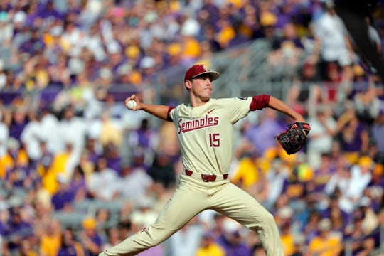 Florida State pitcher C.J. Van Eyk throws in the first inning against LSU during Game 2 of the NCAA college baseball super regional tournament in Baton Rouge, La., Sunday, June 9, 2019. (AP Photo/Gerald Herbert)