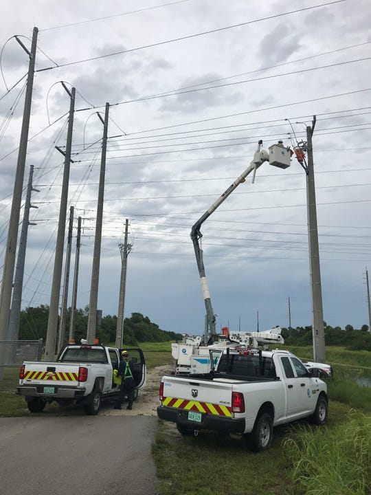 FPL crew members near Home Depot on 58th Avenue just south of State Road 60 in Indian River County, repairing damaged equipment.