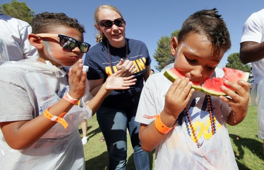 A watermelon-eating contest was part of the fun at the eighth annual UTEP Alumni Pick-Nic on Saturday, June 8, 2019, at Memorial Park. The event was a sellout, with more than 400 people attending.