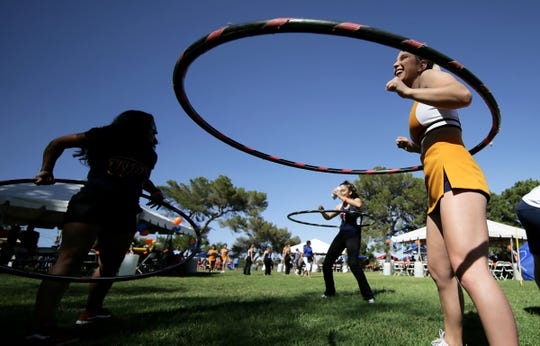 A UTEP cheerleader joins the hula-hoop fun Saturday, June 8, 2019, during the eight annual UTEP Alumni Pick-Nic at the Memorial Park Reserve Area. More than 400 attended, organizers said.