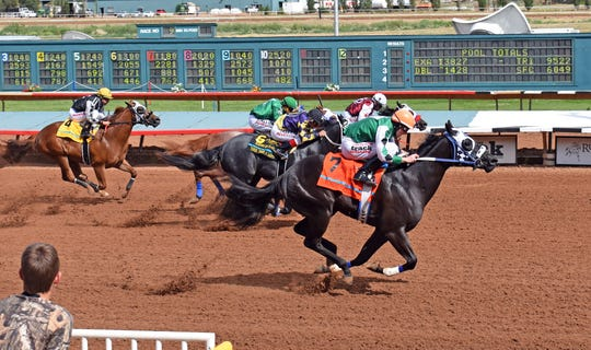 Midnight Moonlyte won the Ruidoso Juvenile Sunday for two-year-old quarter horses.
