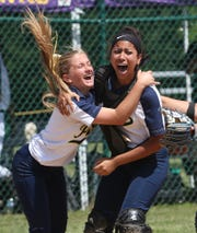 From left, Walter Panas pitcher Olivia Bordenaro and catcher Kat Reynoso celebrate after defeating Minisink Valley 2-0 in the regional final at Rhienbeck High School June 7, 2019.