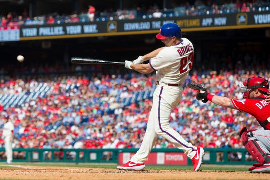 PHILADELPHIA, PA - JUNE 08: Jay Bruce #23 of the Philadelphia Phillies hits a bases loaded two RBI single in the bottom of the first inning against the Cincinnati Reds at Citizens Bank Park on June 8, 2019 in Philadelphia, Pennsylvania. (Photo by Mitchell Leff/Getty Images)