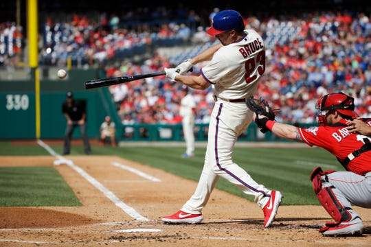 Philadelphia Phillies' Jay Bruce hits a two-run single off of Cincinnati Reds starting pitcher Tanner Roark during the first inning of a baseball game, Saturday, June 8, 2019, in Philadelphia. (AP Photo/Matt Rourke)
