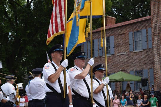 The Goodwill Fire Co. marches in front of the Courthouse Museum in New Castle, Del., in the Separation Day parade on Saturday.