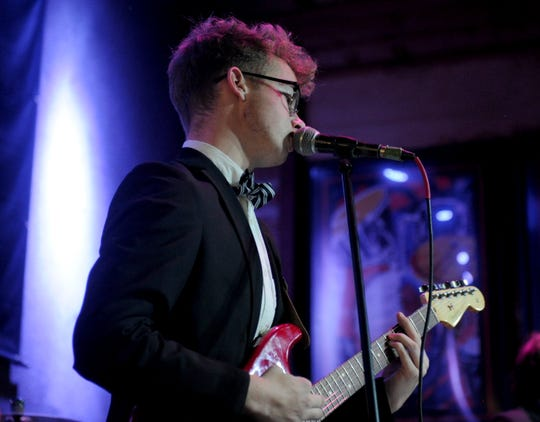 Logan Potter performs with K. Schultz & Associates to raise money for the Backdoor Theatre Youth Program Sunday, June 9, 2019, at the Backdoor Theatre's Battle of the Bands in Iron Horse Pub.