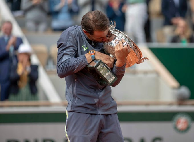 June 9: Rafael Nadal poses with the trophy after defeating Dominic Thiem in the men's final.