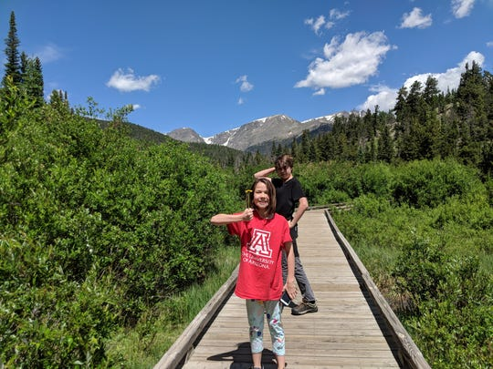 Erysse and Iden Elliott strike a silly pose in Rocky Mountain National Park in 2018.